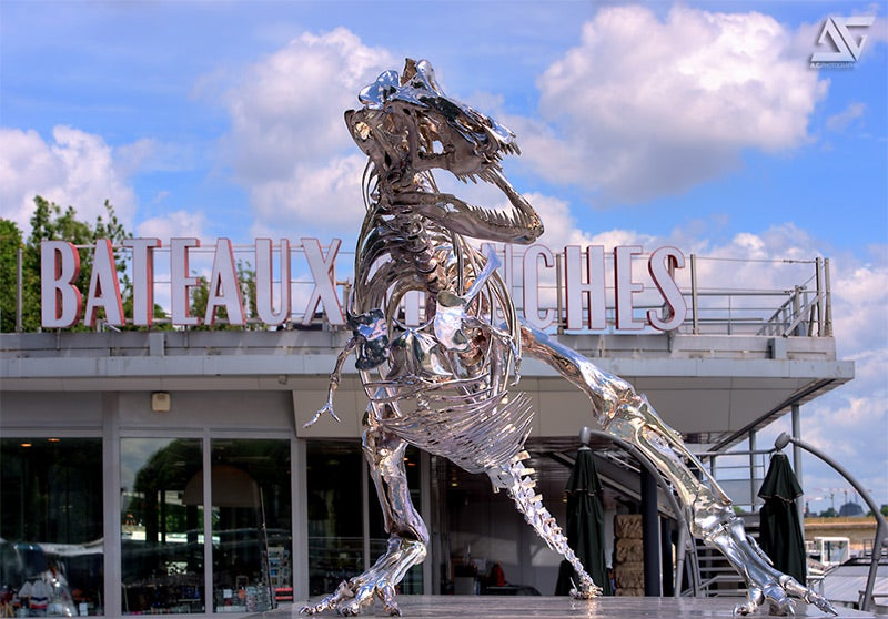 Incredible chrome T-rex skeleton scavenges on the banks of the Seine