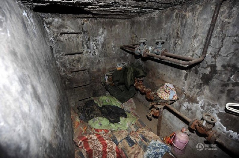 China's Underground Dwellers Find Their Homes Cemented Shut