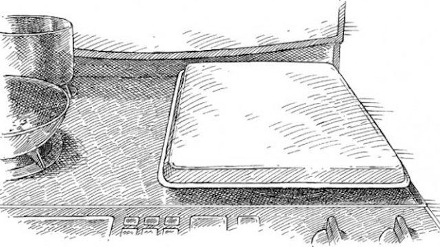 Use an Upside-Down Baking Pan to Reduce Stovetop Splatter