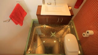 The Bathroom That Was Built on an Elevator Shaft Has a See-Thru Floor