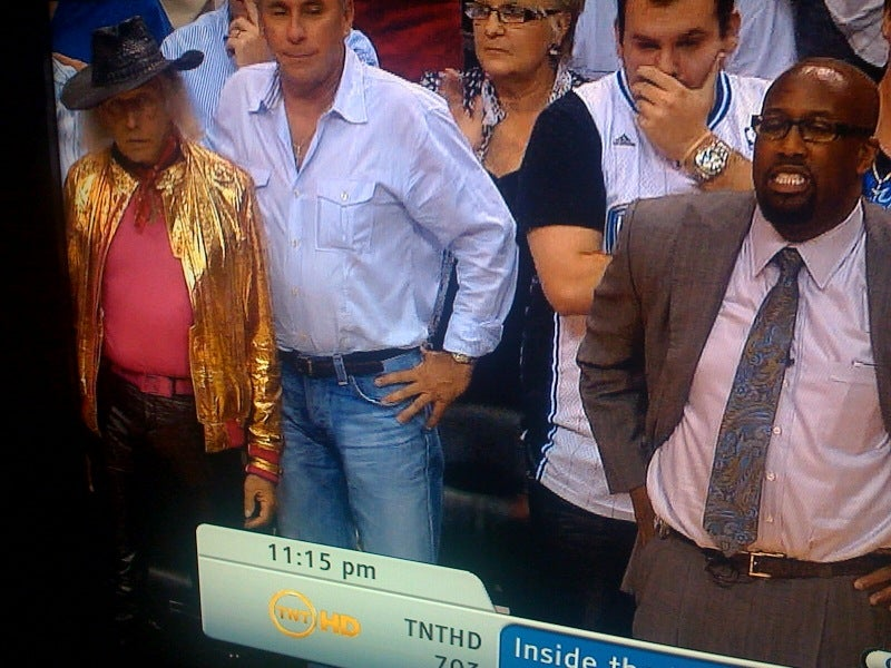 Scary Old She-Male In Plastic Gold Jacket Haunts The Sidelines (UPDATE)