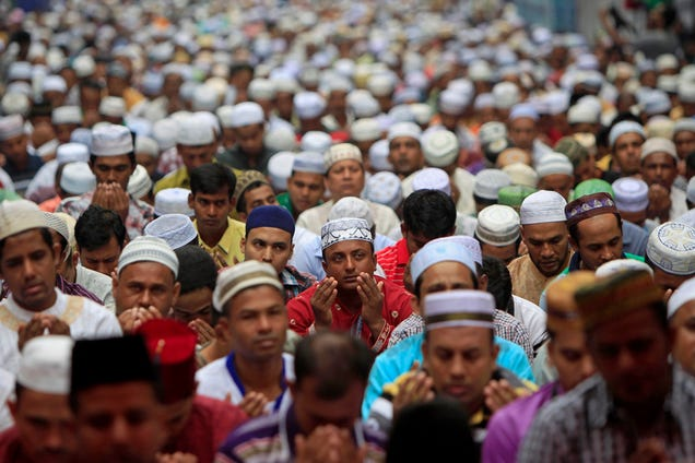 Hundreds of Bangladeshi Muslims pray on the first day of Eid al-Fitr in Kuala Lumpur, Monday.