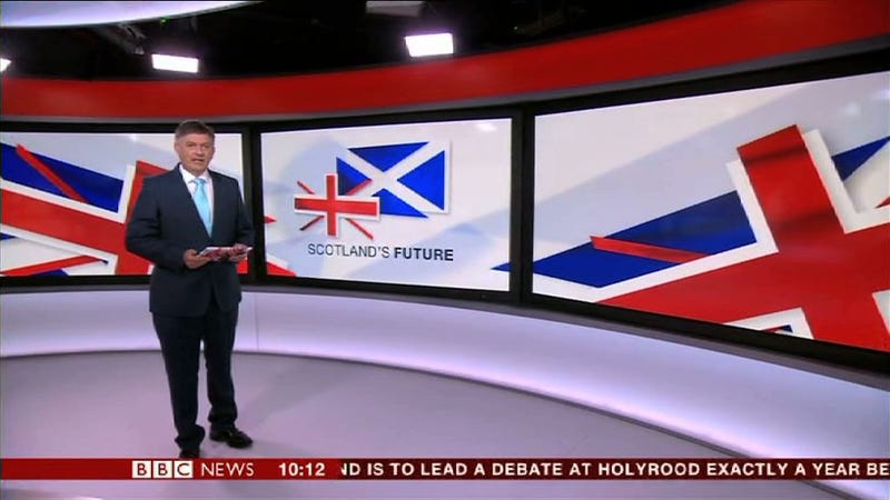 BBC Presenter Introduces News Report Holding A Pack Of Printer Paper
