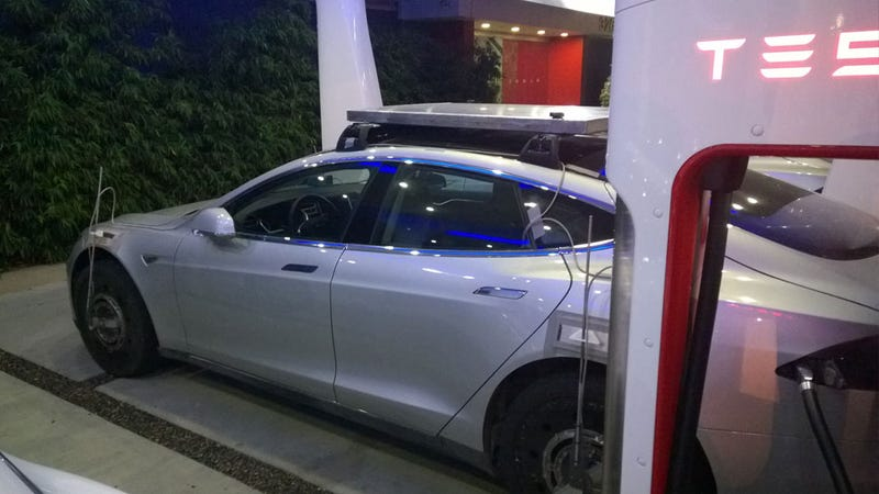 Tesla Model X Test Mule Is A Model S With Weights On The Roof