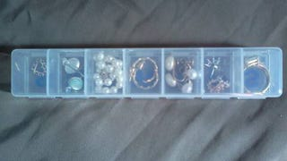 Use a Pill Box to Organize Jewelry and Small Items While Traveling