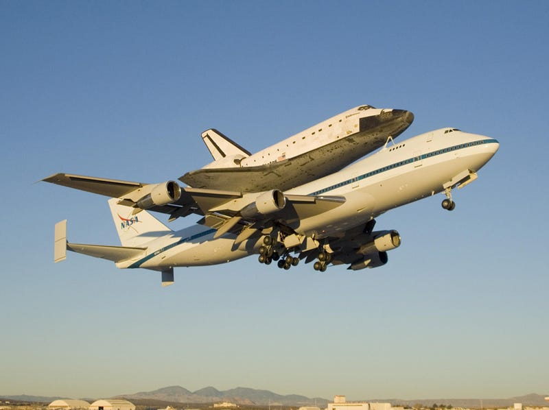 Stunning Zenithal Shot of Space Shuttle Flying On Top of 747