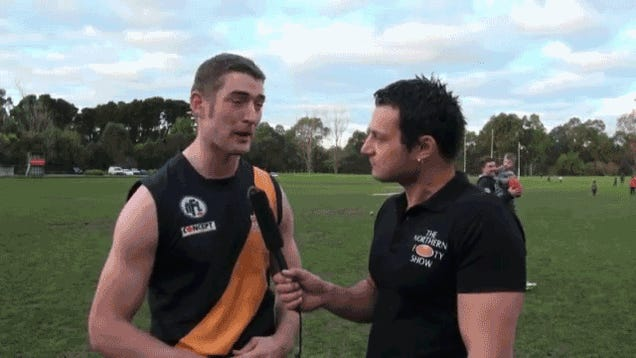 Dad Totally Drops Kid In Background Of Aussie Rules Football Interview