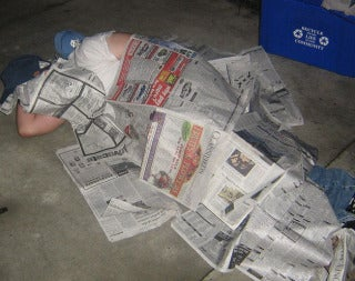 Haitians Demand Newspaper Blankets