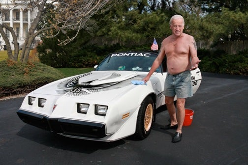 The Onion: Shirtless Biden Washes Trans Am In White House Driveway