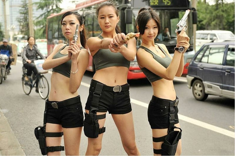 Chinese Lara Croft Lookalikes Handing Out Traffic Warnings in Hotpants