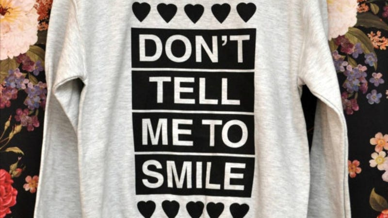 We Need This 'Don't Tell Me to Smile' Sweatshirt