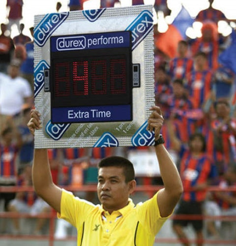 Fourth Official Holds Up A Massive Electrical Condom