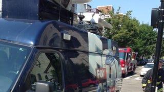 FOX news van crew blocks fire hydrant in front of Boston church fire