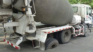 Cement truck gets stuck in road