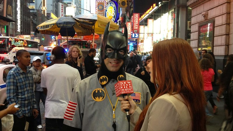 Man Wearing Batman Mask Interviewed Outside of Times Square IMAX Theater