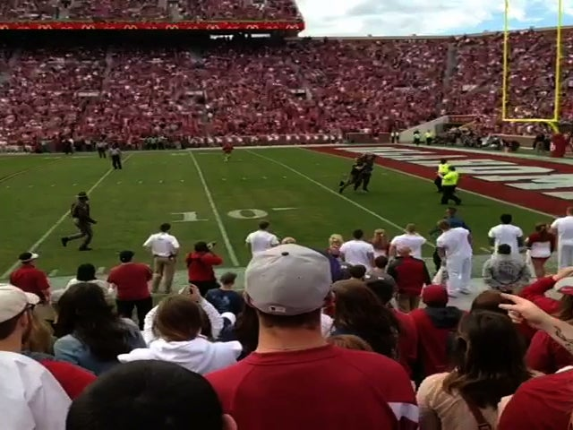 Watch An Oklahoma Idiot On The Field Get Leveled By State Trooper