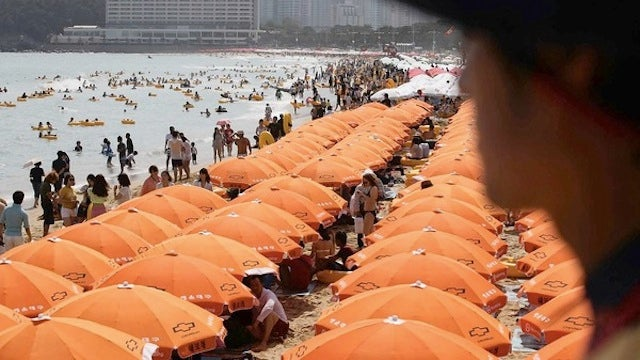 What Kind of Beach Uses 7,937 Umbrellas to Block Out the Sun? A Freaking Weird One.