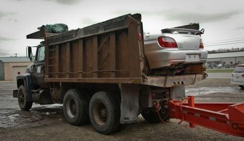 Subaru Impreza Takes A Dump Truck Ride To Guatemala