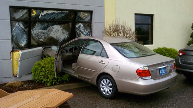 Beige Toyota Camry Crashes Into Ford Dealership In Failed Attempt At Revenge