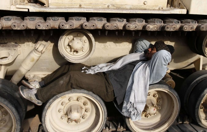 Egyptian Protestor Uses Tank as Hammock