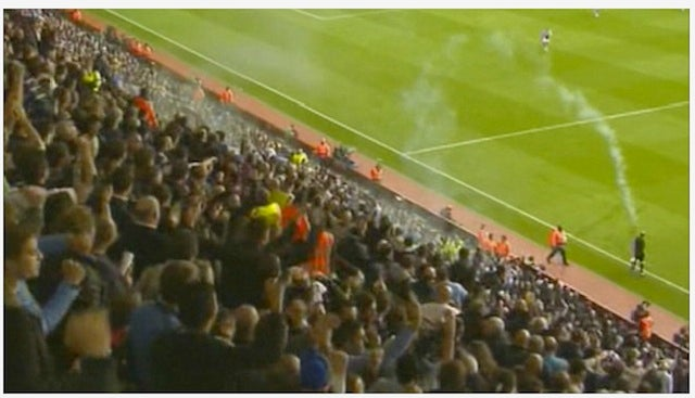 Referee Hit With Smoke Bomb Thrown By Tottenham Supporter