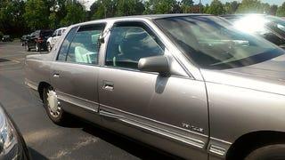 When did Cadillac stop offering manual door locks?