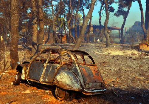 Greek Wildfires Claim Lives Of Numerous Cars