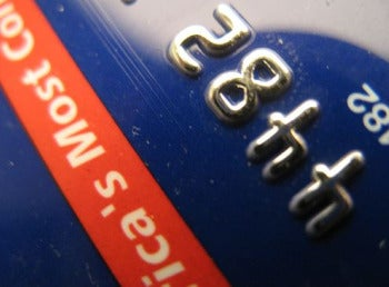 Should You Pay Off A High Balance or High Interest Rate Credit Card First?