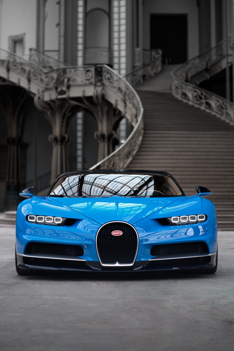 'Bugatti Chiron: This Is A Lot More Of It ' from the web at 'http://i.kinja-img.com/gawker-media/image/upload/s--YZioZMfB--/c_scale,fl_progressive,q_80,w_800/sjyakfxecnlq53tvksf8.jpg'