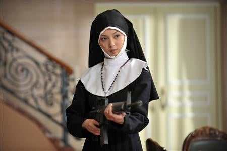 She's a Nun. An Evil Nun. With a Machine Gun.