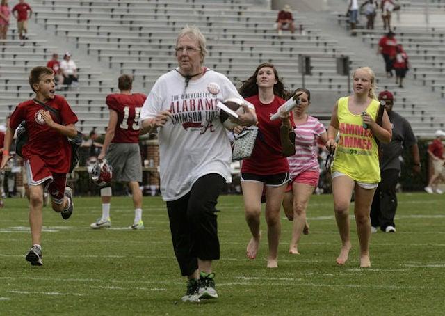 Alabama Fans Sprint For Nick Saban's Autograph