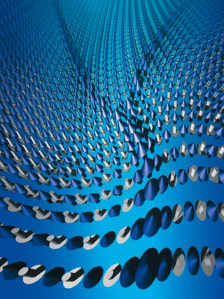Meet Two New Quantum Particles: Spinons and Holons
