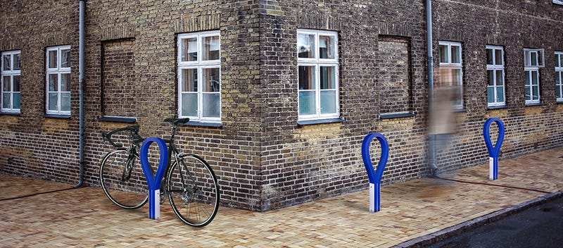 This Colorful Rubber Bike Rack Won't Scratch Or Ding Your Favorite Ride