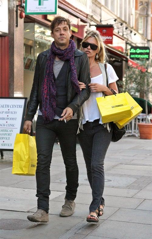 Kate Moss: Always Stylish, Suddenly Camera-Shy