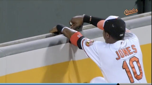 Adam Jones Reaches For Home Run, Gets Glove Stuck In Wall