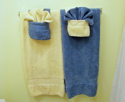 Keep your bathroom looking fancy by folding towels with for Bathroom towel folding designs