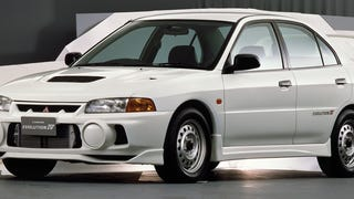 [Ever wondered how carmakers take those pictures with perfectly clear white backgrounds? Here's how. Also, dig the steelies on this '96 Evo IV RS. Photo Credit: Mitsubishi]