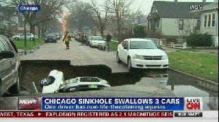 I Can't Stop Watching This Dodge Avenger Fall Into A Sinkhole