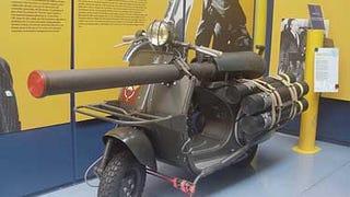 Yes, it's a Vespa, yes it has a piece of artillery on it.