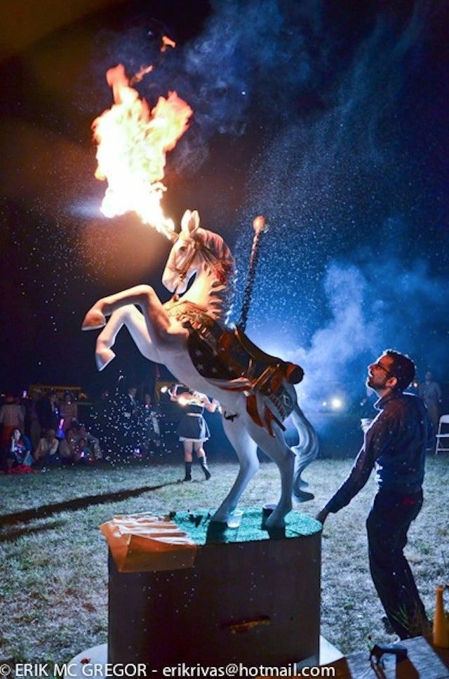 Magical unicorn sculpture pees lemonade and shoots fire from its horn