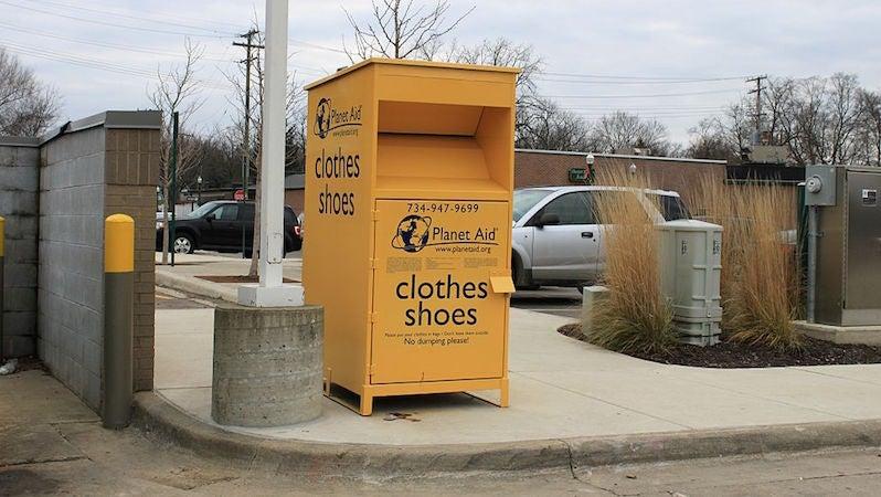 Planet Aid's Yellow Clothing Donation Bins Are Part of a Global Cultlike Scam