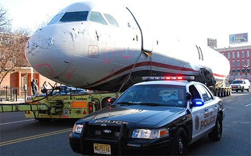 US Airways Flight 1549 Towed Through Jersey Streets