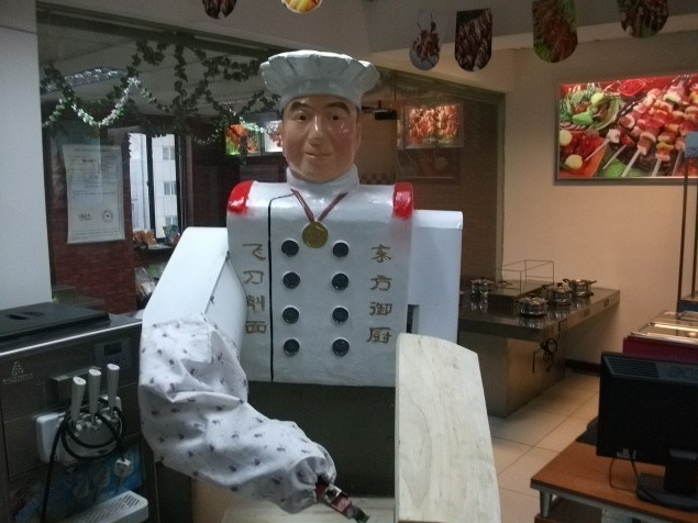 Holy Crap, an Army of Robots Ready To Slice Your Noodles