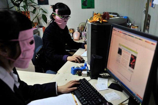 China's Radiation Masks Sure Make Computer Work Interesting