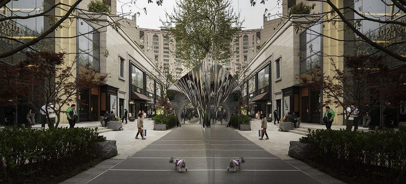 This Twisting Mirror Bridge Reflects Every Detail of a Shanghai Street
