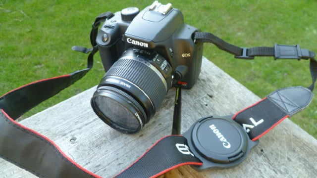 Thread the Lens Cap Holder Onto the Strap, and Click the Cap Into Place to Stop Losing Them