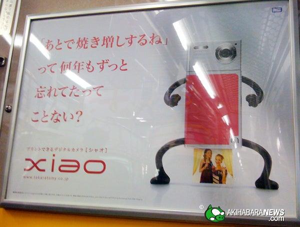 Caption Contest: The TakaraTomy Xiao Printer-Camera