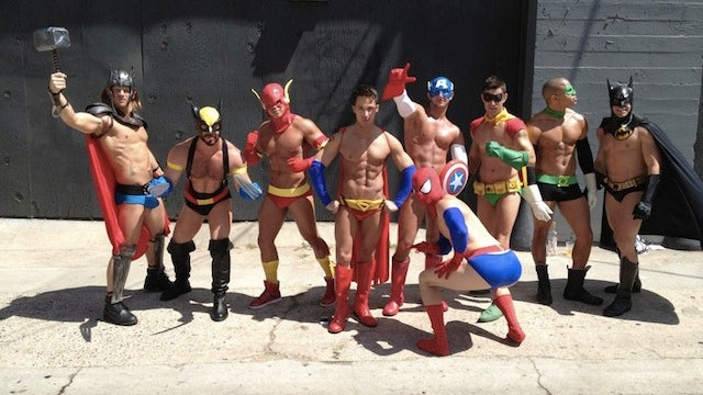 Cosplaying gentlemen assemble in skimpy versions of male superhero costumes