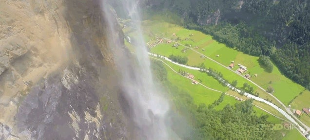 Mad man in a wingsuit flies through a waterfall