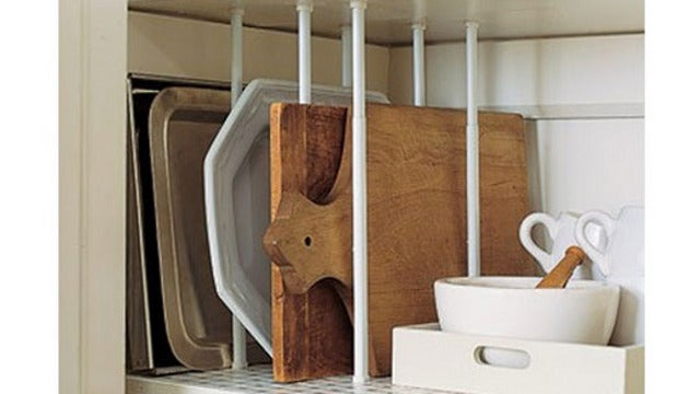 Repurpose Tension Curtain Rods into Pantry Dividers